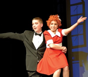"Cedar Rapids LaSalle Middle School sixth-graders Colin Battien and Samantha Robinson perform a musical number as Oliver Warbucks and Annie in ""Annie, Jr.,"" Dec. 4-5, 2014. (Contributed photo)"